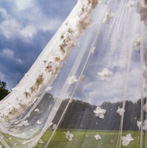 portrait-bride-groom-veil-wind